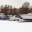 Boats at the winter Parking lot — Stock Photo #24848833