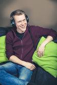 Listening music with headphones — Stock Photo