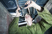 Mechanic under car — Stock Photo