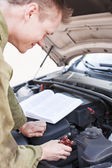 Mechanic replacing broken part — Stock Photo