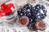 Glass Jar, Neddle Case and Buttons on Fabric. — Stock Photo