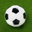 Soccer ball and artificial turf — Stock Photo