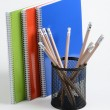 Stock Photo: Notebooks and pens