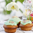 Muffins with green icing and colorful sprinkles — Stock Photo #21693869