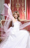Beautiful very happy bride in luxurious interior — Stock Photo