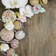 Sweets on wooden background — Stock Photo #23725151