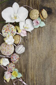 Sweets on wooden background — Stock Photo
