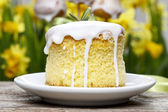 Easter cake, yellow daffodils in the background — Stock Photo