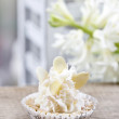 Pretty small cupcakes, lavishly decorated, on wooden table — Stock Photo