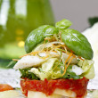 Halibut with fresh vegetables, green candle in the background - Stock Photo