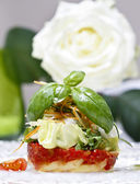 Halibut with fresh vegetables, white rose in the background — Stock Photo
