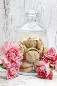Parisian macarons among pink carnation flowers — Stock Photo