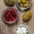 Top view on various appetizers: olives, cranberry, cottage chees — Stock Photo
