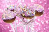 Pink cake pops decorated with colorful sprinkles — Stock Photo