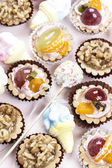 Group of cupcakes and other sweet — Stock Photo