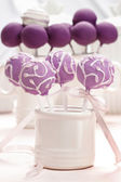 Lilac cake pops decorated lavishly decorated with icing. — Stock Photo