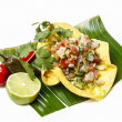 Mexican salad in a tortilla on banana leaf, isolated on white — Stok fotoğraf