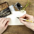 Girl writing a letter with ink pen — Stock fotografie