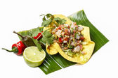 Mexican salad in a tortilla on banana leaf, isolated on white — Stock Photo