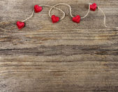 Cute red hearts on wooden background. Copy space. — 图库照片