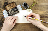 Girl writing a letter with ink pen — Stock Photo