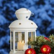Beautiful white lantern on snowy evening landscape. Christmas de — Stock Photo