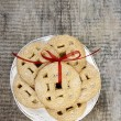 Top view of cookies with red bow on wooden table. — Stock Photo