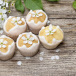 Tiny cakes on wooden background, springtime set. — Stock Photo