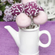 Purple and lilac cake pops in white ceramic jug, birthday party. — Stock Photo