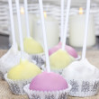 Colorful cake pops on hessian, birthday party. Candles in the ba — Foto de Stock