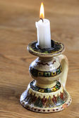 White candle on vintage candle holder — Stock Photo