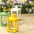 Beautiful colorful lanterns on wooden table at summer party. — Stock Photo