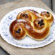 Stock Photo: Traditional swedish saffron buns on hessian.