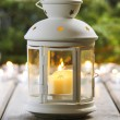 Stock Photo: White lantern on wooden rustic table.