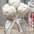 White chocolate cake pops in glass jar on wooden background — Stock Photo #26224205