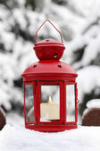 Red lantern, winter garden decor — Stock Photo