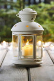 White lantern on wooden rustic table. — Stock Photo