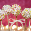 White chocolate cake pops decorated with colorful sprinkles. — Stock Photo #26512955