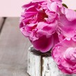 Pink peony flower on wooden table — Stock Photo #26513707