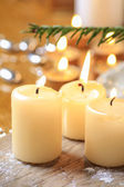 Beautiful golden candles. Christmas eve mood. Selective focus — Stock Photo