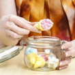 Girl snacking sweets between meals — Stock Photo
