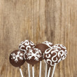 Chocolate cake pops on wooden background. Copy space. — Stock Photo #26543421