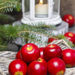 Red apples in basket. Traditional christmas setting. — Stock Photo