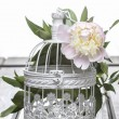 Pink peony in wicker basket on rustic wooden table. — Stock Photo #26544593