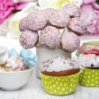 Pastel cake pops, cupcakes and marshmallows on rustic table — Stock Photo #26743381