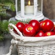 Stock Photo: Red apples in basket. Traditional christmas setting.