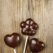 Chocolate cake pops in heart and flower shapes — Stock Photo