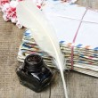 Package of old letters and pink carnation flowers isolated — 图库照片