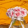 Bouquet of carnation flowers in glass vase on wooden table — Stock Photo
