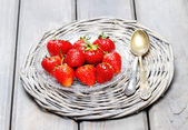 Strawberries on wicker grey tray — Stock Photo